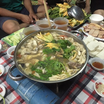 Those are jugs of rice wine behind the pot!